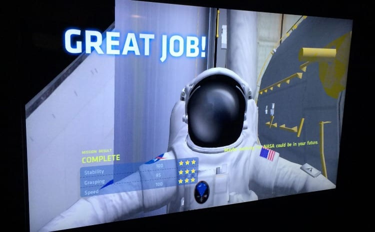 Space Shuttle Atlantis interactive exhibits at Kennedy Space Center via We3Travel.com