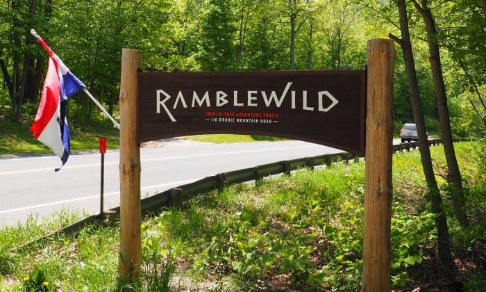 Soaring through the trees at Ramblewild tree-to-tree aerial adventure course in the Berkshire Mountains of Massachusetts