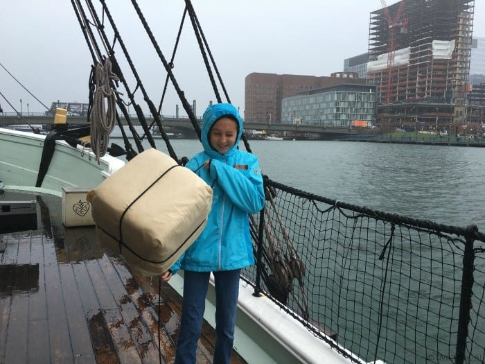 Throwing tea into the water at the Boston Tea Party Ships and Museum