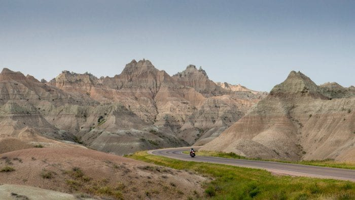 Badlands national park road with motorcycle