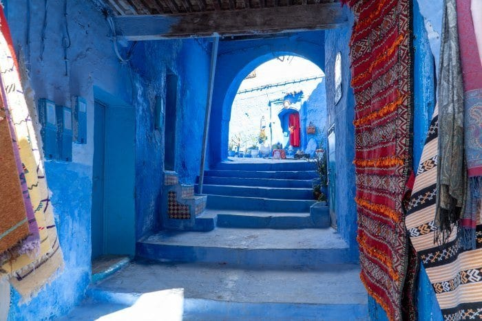 Blue street with rugs