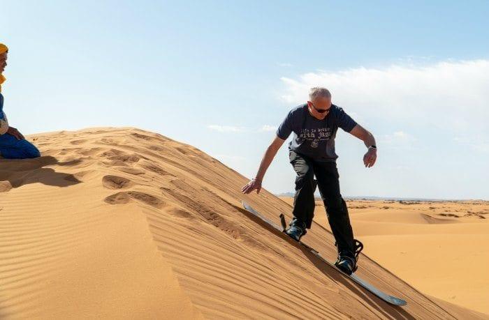 Glenn sand boarding on the dunes