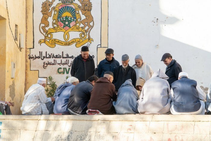 Men playing cards in the medina of Fes