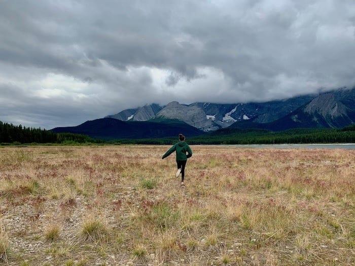Running through the meadow at Lower Kananaskis Lake