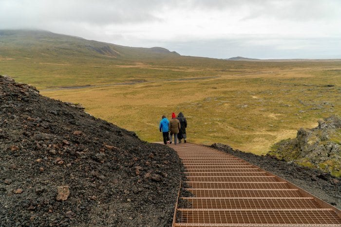 Climbing down the stairs at Saxholl Crater