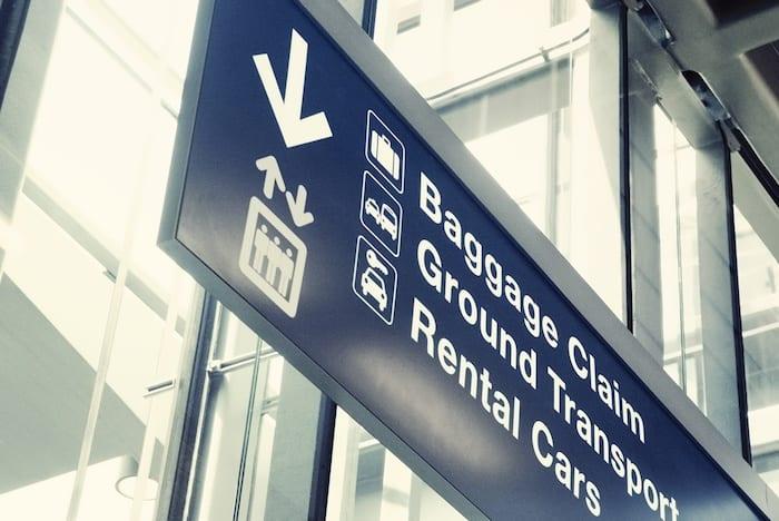 airport baggage rental sign