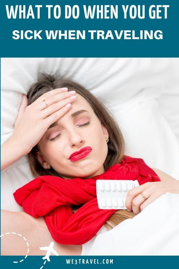 What to do when you get sick when traveling - woman in red scarf in bed holding forehead and pills