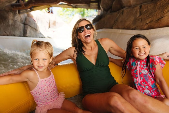 woman and two girls in a raft at Typhoon Lagoon