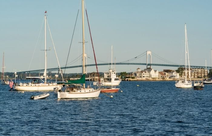 Boats in the harbor in front of Pell Bridge in Newport