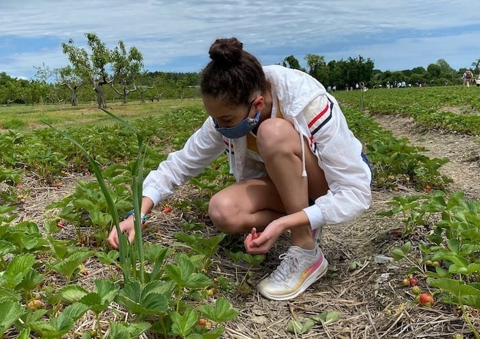 teen strawberry picking