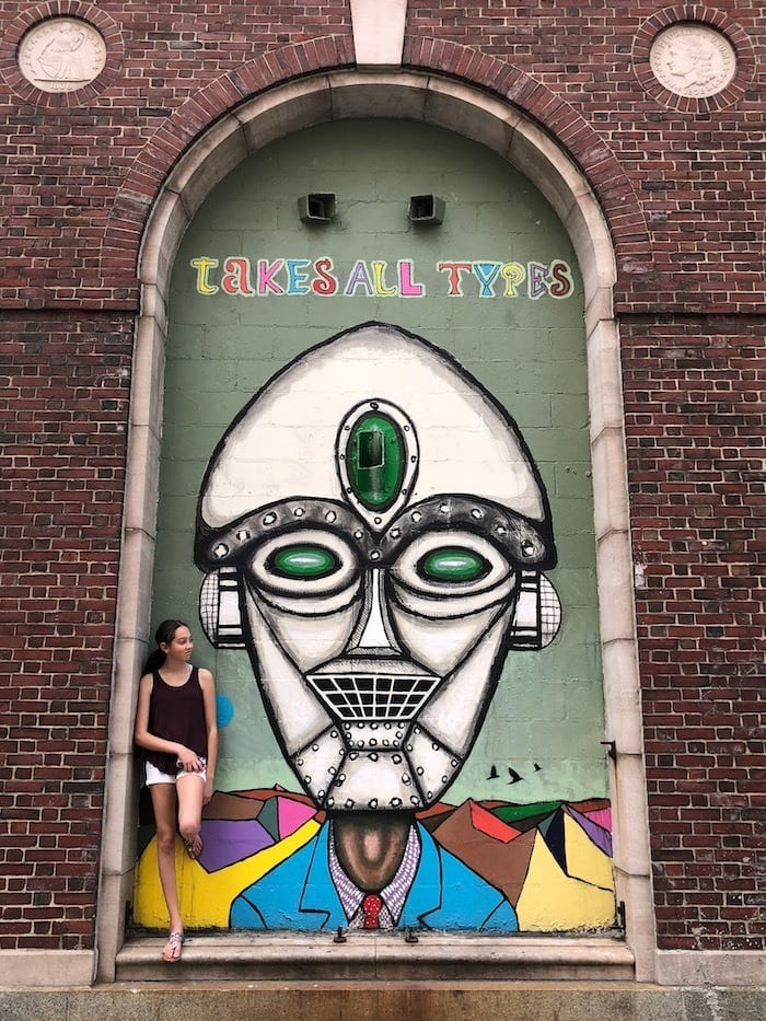teen girl in front of street mural in Providence