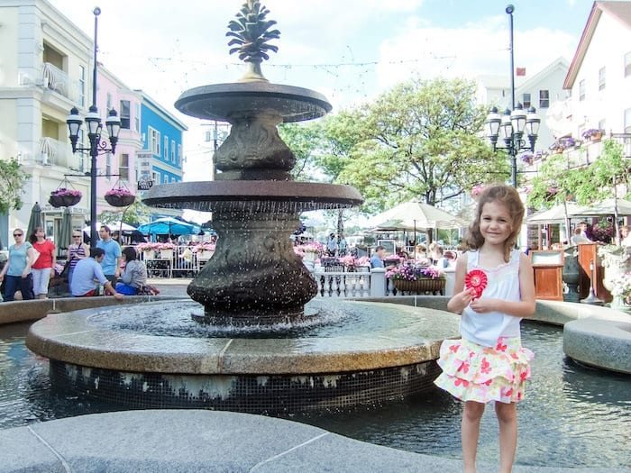 Little girl in front of fountain in DePasquale Square in Providence