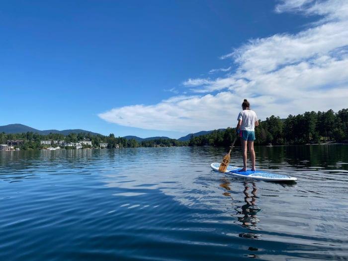 girl paddle boarding on Mirror Lake
