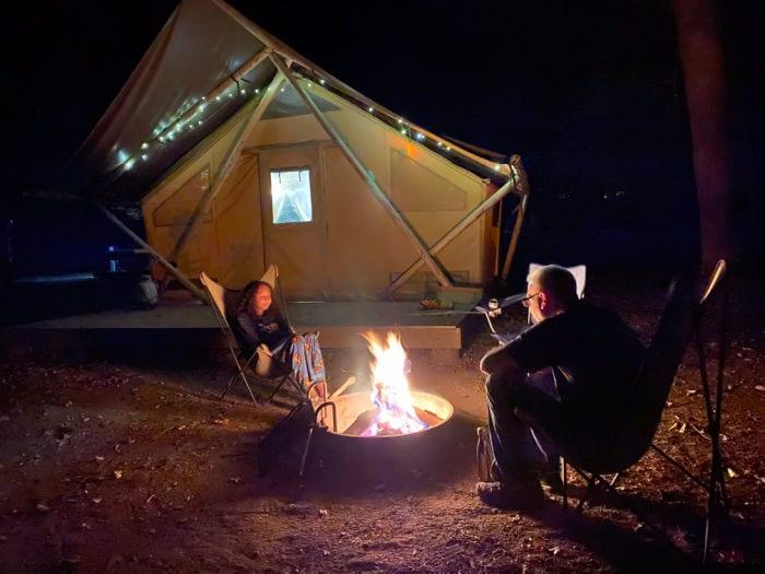 Huttopia campfire outside of tent