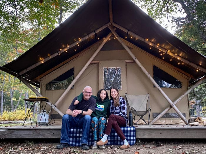 Family in front of Huttopia tent