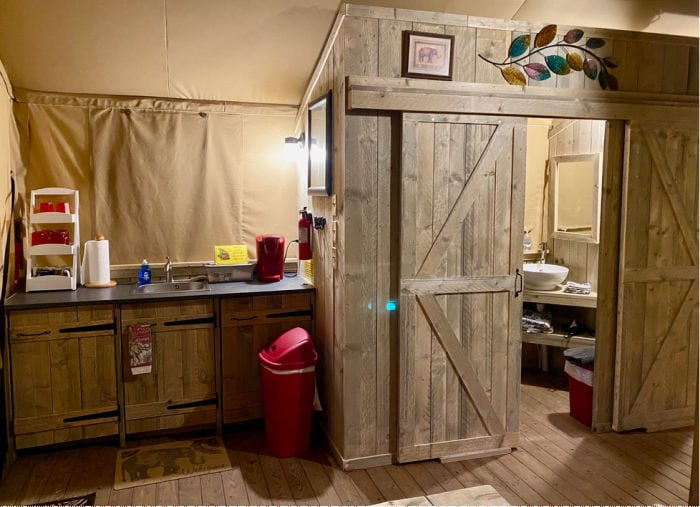 KOA glamping tent kitchen area with sink and coffee maker