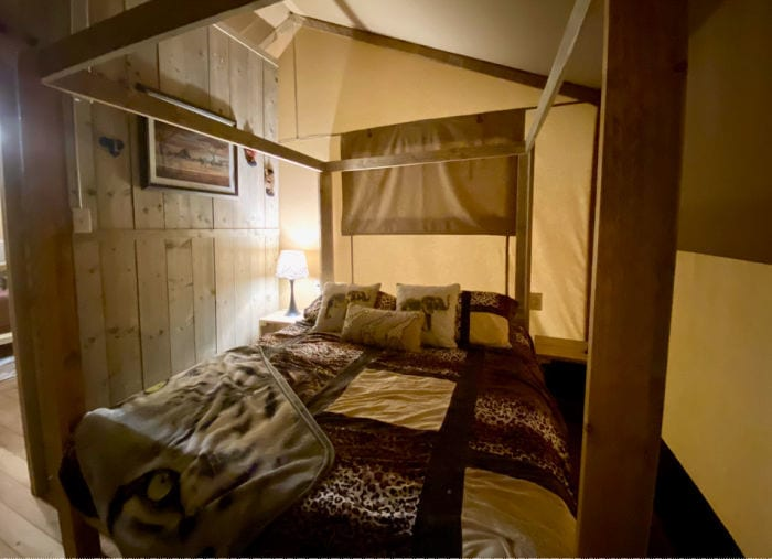 KOA glamping tent main bedroom with queen four poster bed