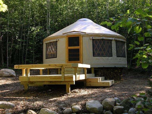 Frost Mountain Yurts Mountain view white yurt with porch