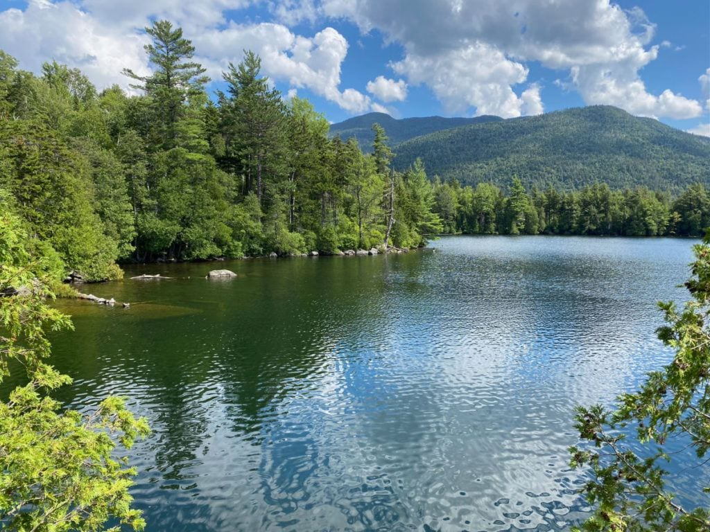 Copperas Pond with trees and mountains in the background