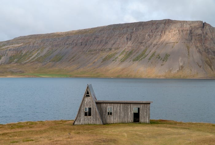 A frame house on the water in the West Fjords in Iceland