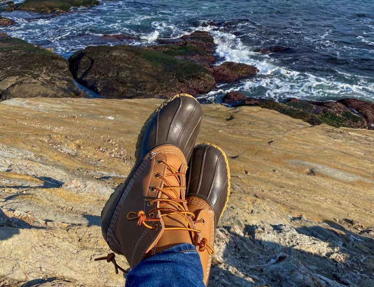 LL Bean Boots on with rocks and ocean in the background