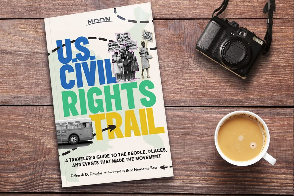 Moon Guide U.S. Civil Rights Trail guidebook with camera and coffee cup