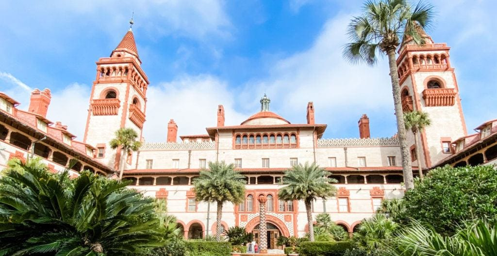 Flagler college bell towers and entrance with palm trees