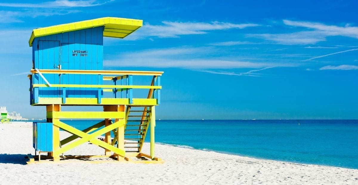 Blue and yellow lifeguard stand on Miami Beach