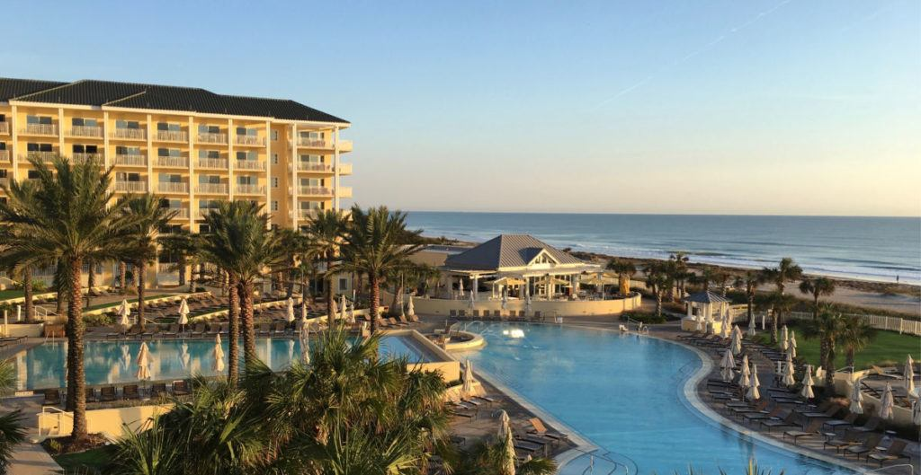 Omni Hotel Amelia Island pool and towers with ocean in the background