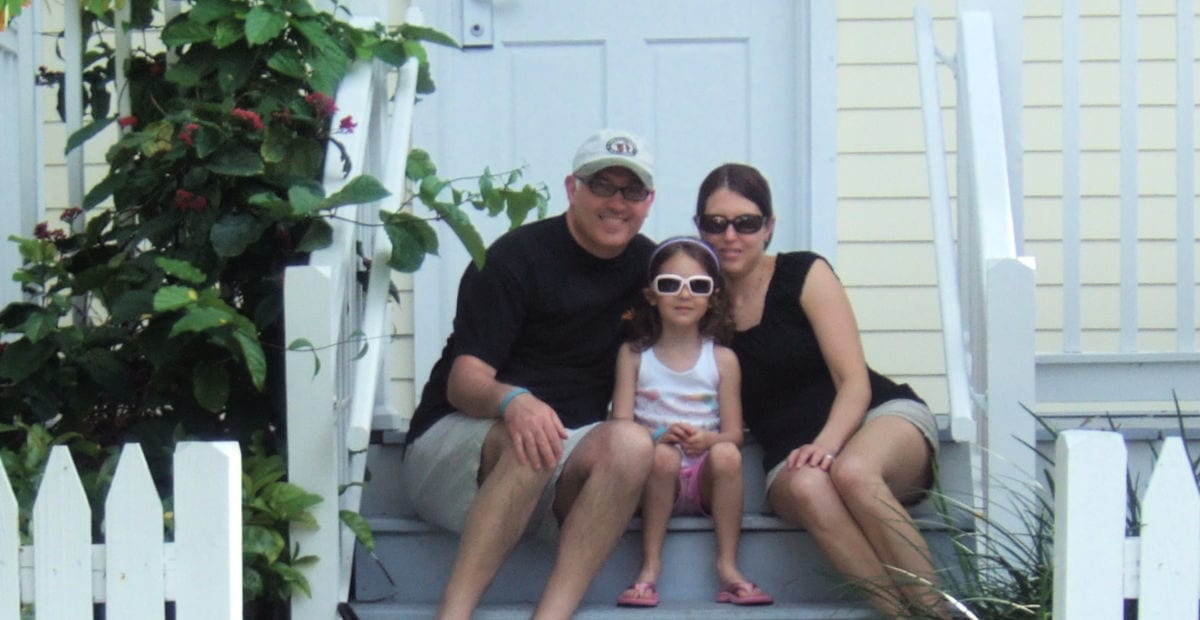 Gruber family on the steps of a yellow villa at Hawk's Cay