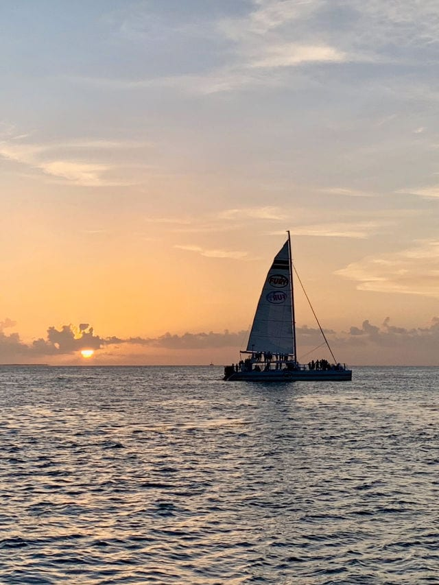 Sailboat on the water at sunset in Key West