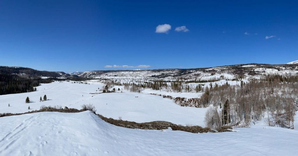View of snow and mountains from Indian Hill near Steamboat Springs, Colorado