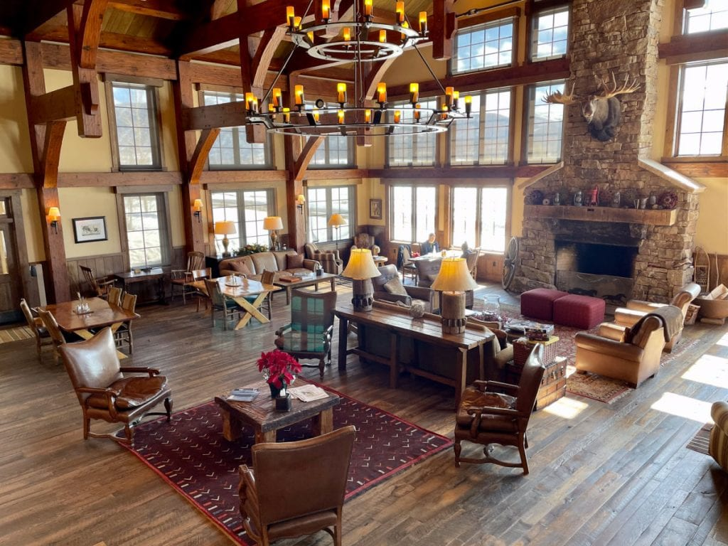 Vista Verde Ranch lodge main room with sofas and fireplace