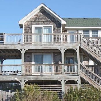 Grey cedar shingled two story beach house from Canva