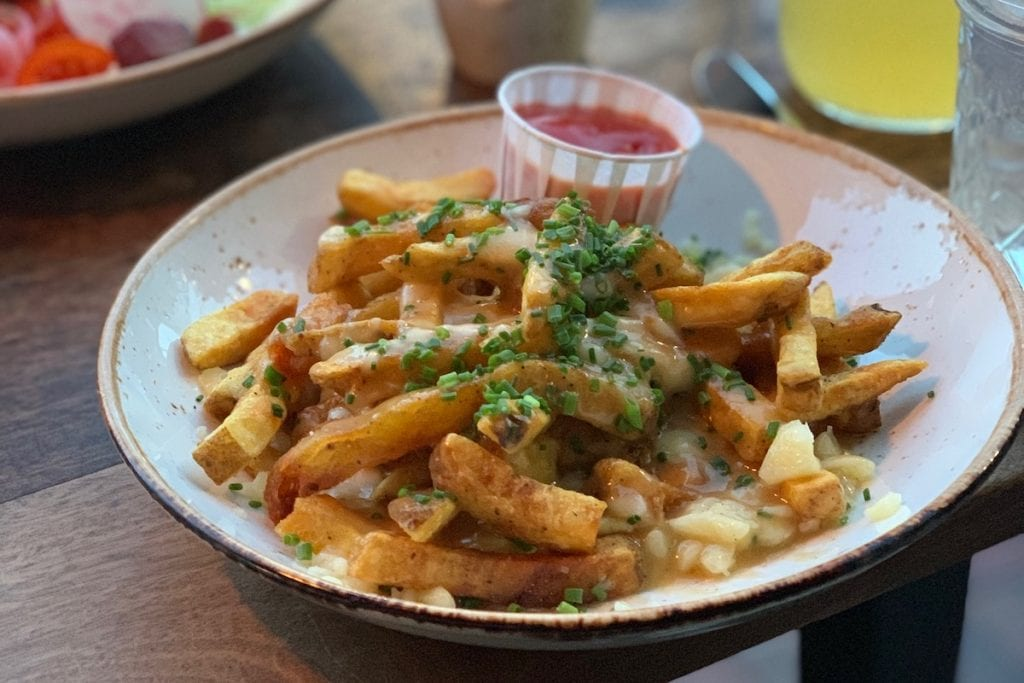 Poutine fries and ketchup from Duckfat in Portland Maine