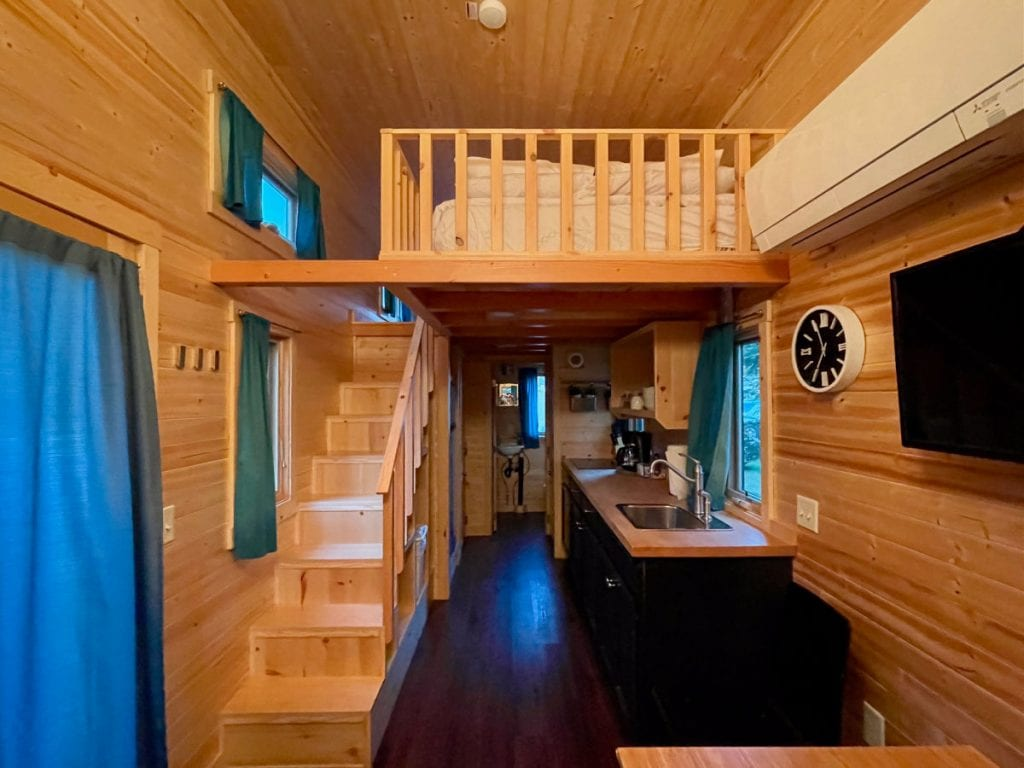 Emerson tiny house kitchen area and stairs to the open sleeping loft