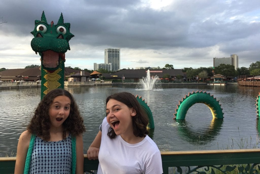 Two girls in front of a sea serpent lego creation at Disney Springs