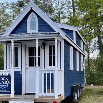 Blue and white Clara style tiny house at Tuxbury Pond