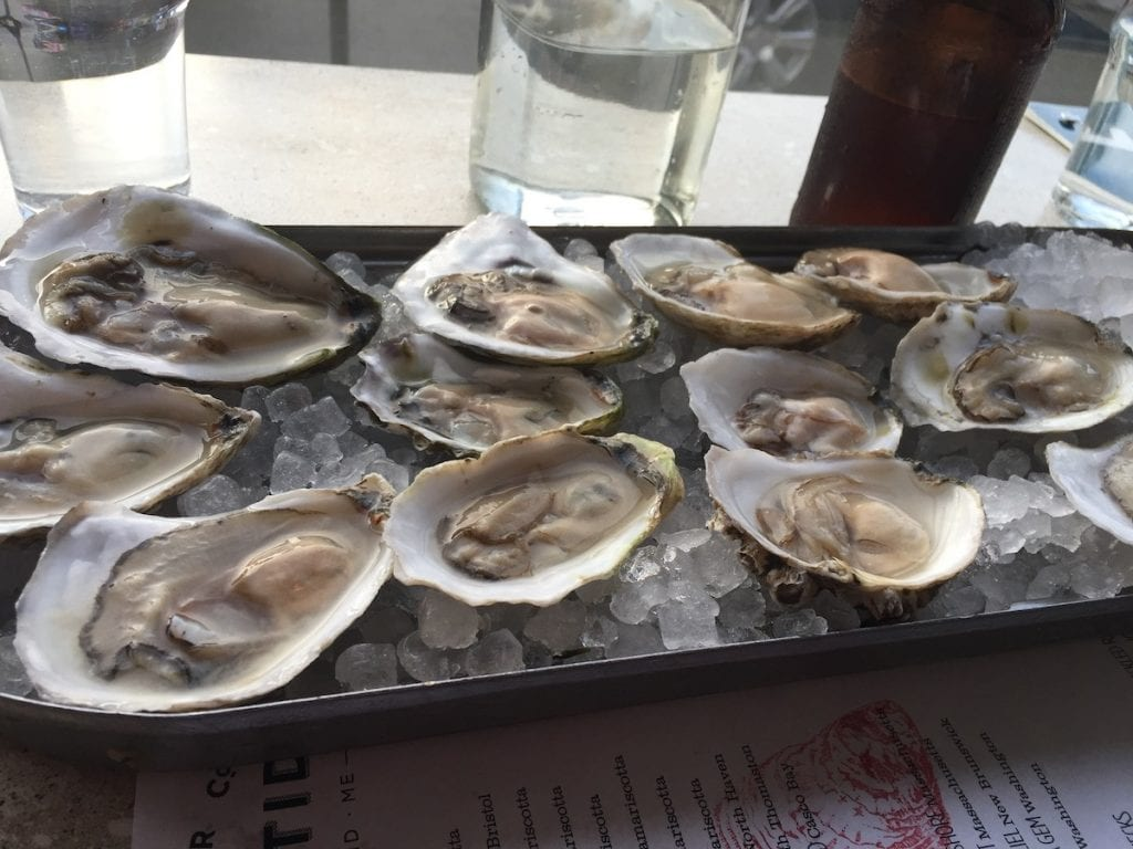 Dozen oysters on a bed of ice at Eventide in Portland Maine