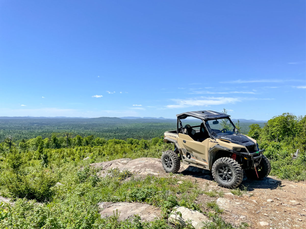 Side by side off road vehicle on mountain top