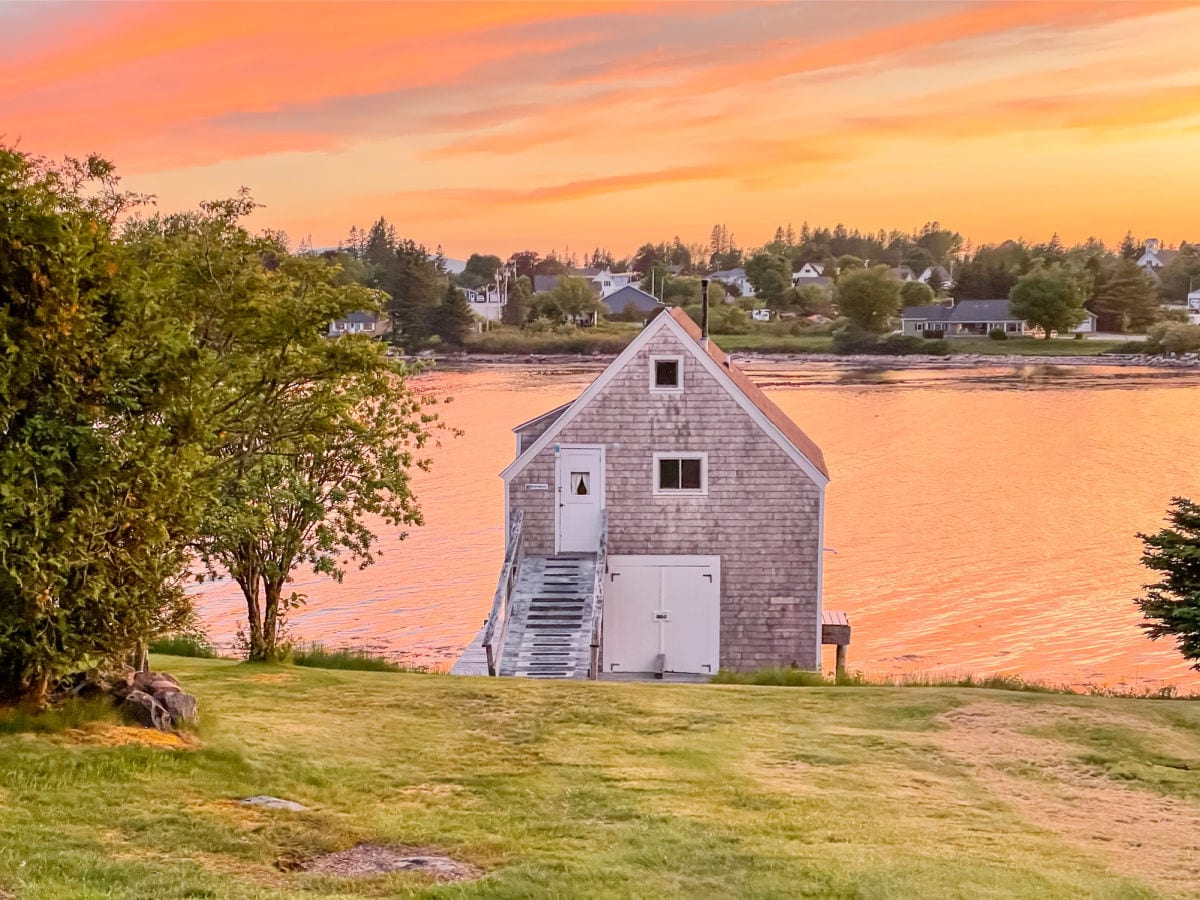 Boathouse at MainStay Cottages and RV park in Winter Harbor Maine at sunset
