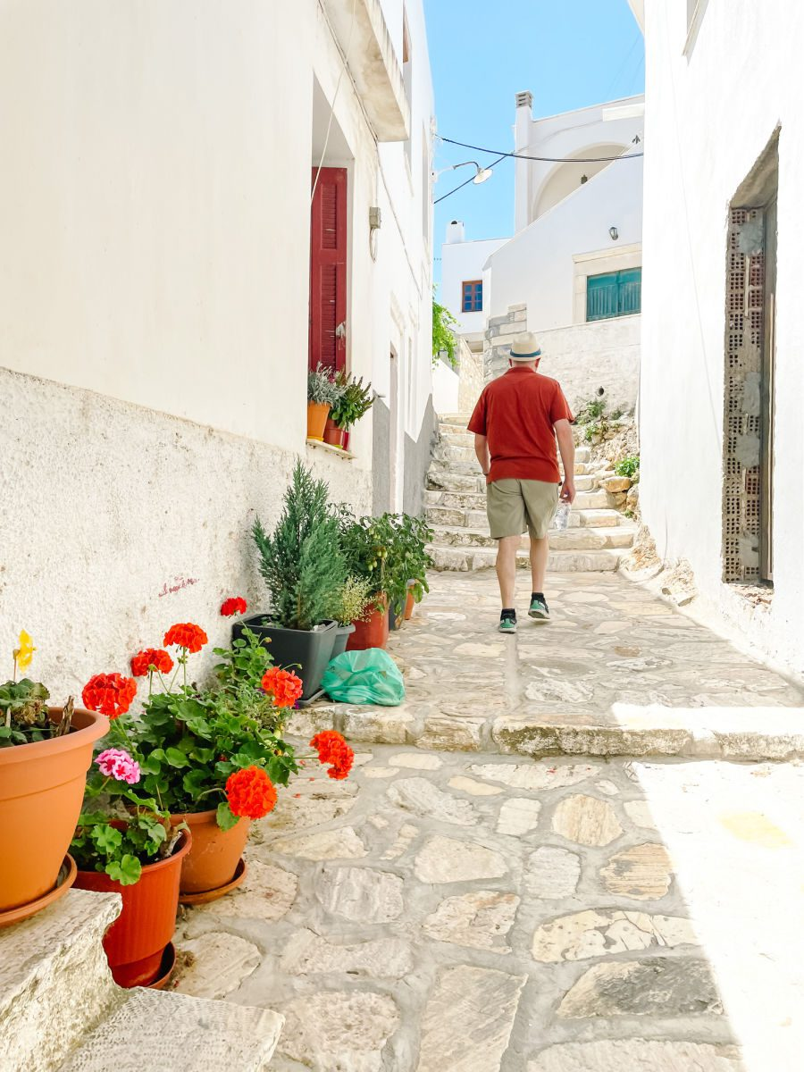 Man walking up steps in town of Apeiranthos