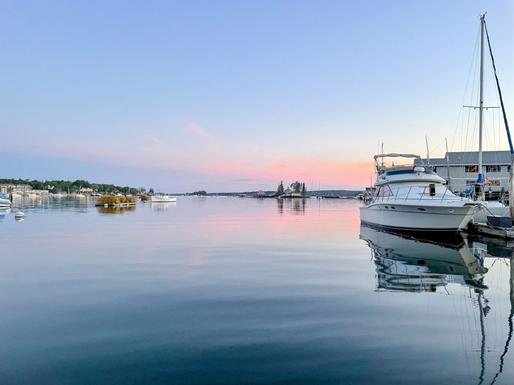 Boats on the water in Boothbay Harbor at sunset