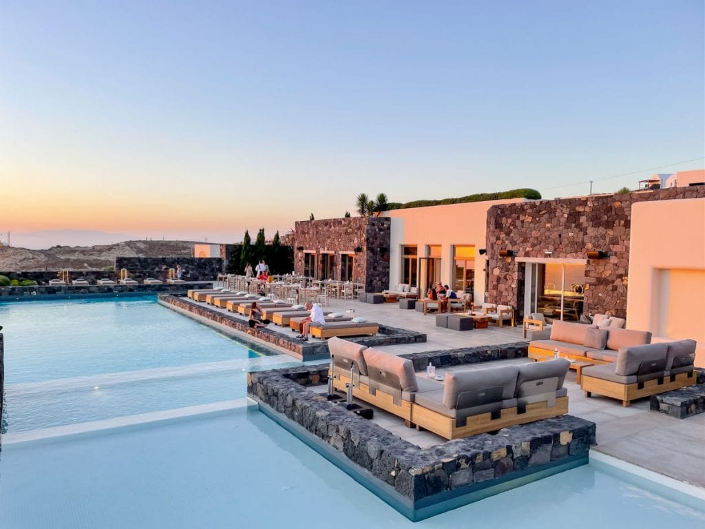 Canaves Epitome pool and building with a sunset glow