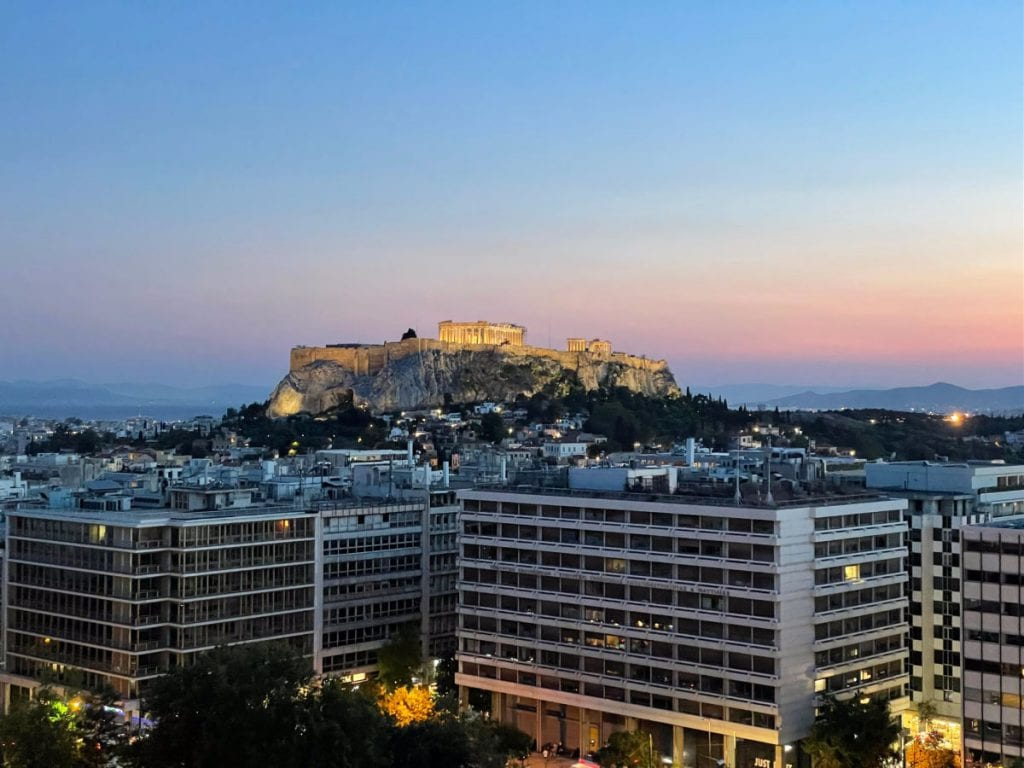 View of the Acropolis and buildings at sunset from the Grand Hotel Bretagne