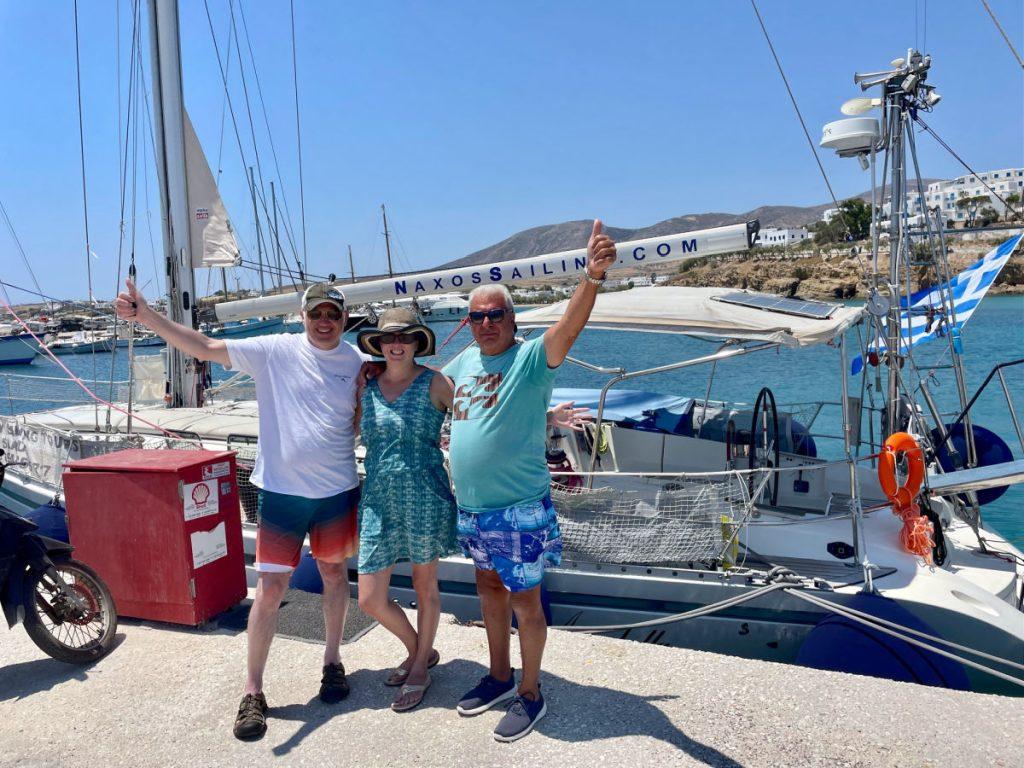 Tamara, Glenn and Captain George in front of Naxos Sailing yacht Annabella