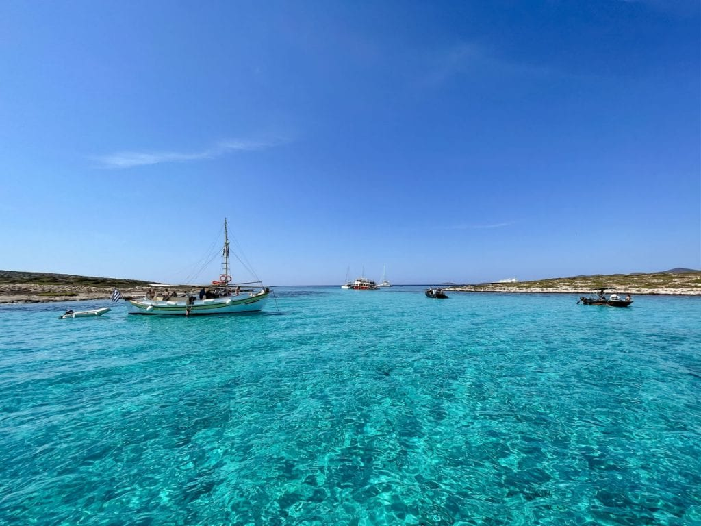 Sailboats on turquoise water off of Paros