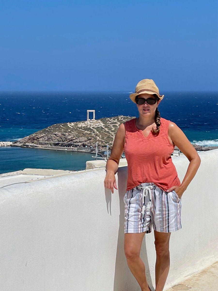 Tamara standing on balcony overlooking Apollo temple