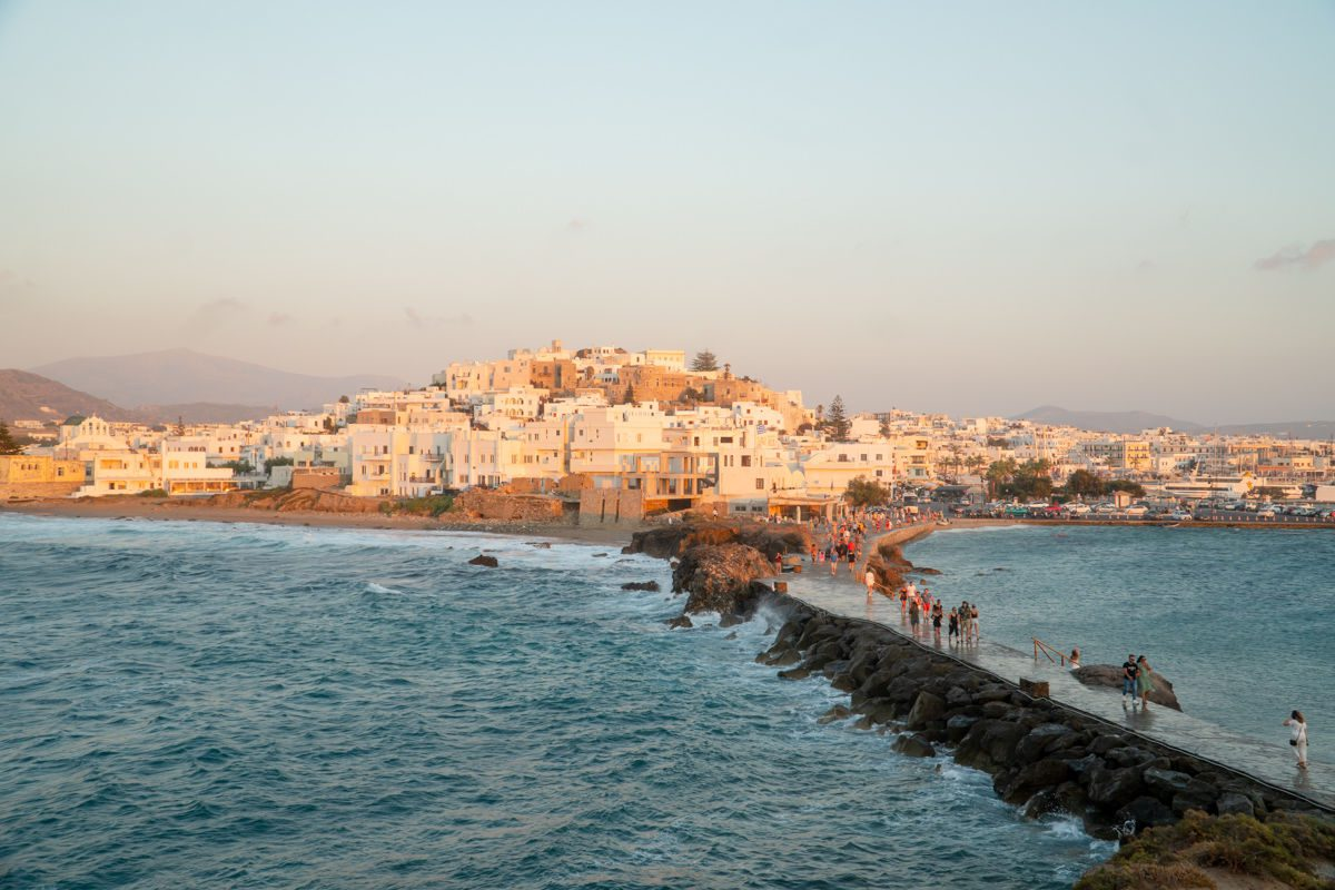 Naxos town from Apollo Temple with path across water at sunset