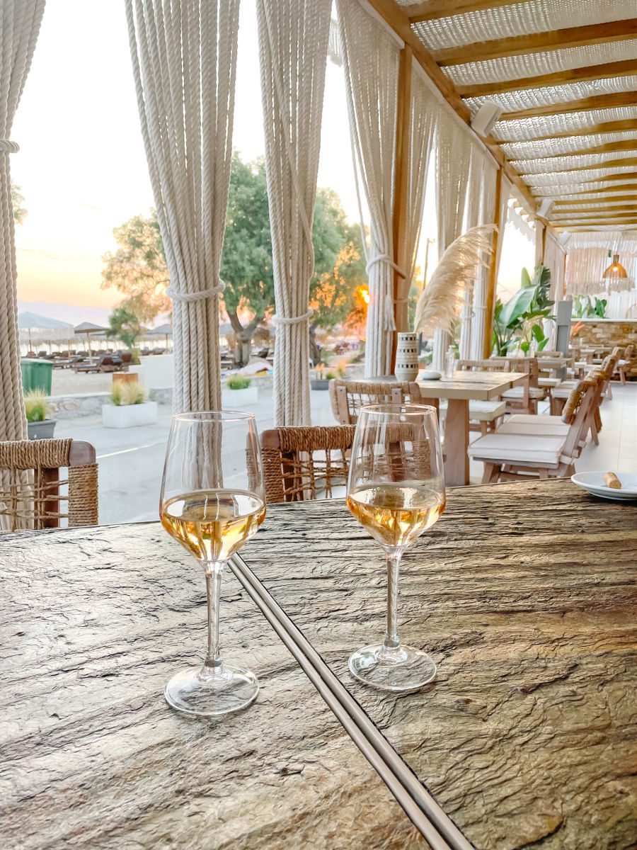 Two wine glasses on table at Virtu Suites restaurant